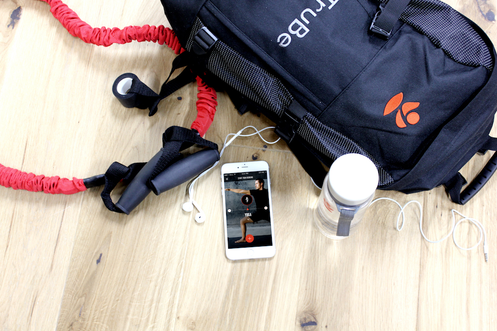 Phone showing TruBe app with fitness equipment